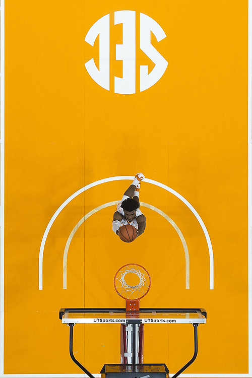 Tennessee's Shembari Phillips (25) dunks the ball on a fast-break during the first half of the game against Auburn. <br /> Auburn Tigers vs. Tennessee Volunteers at Thompson-Boling Arena in Knoxville, Tenn. on Tuesday, Feb. 9, 2016. <br /> Zach Bland/Auburn Athletics