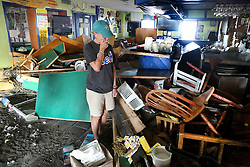 October 9, 2016 - Crescent Beach, Florida, U.S. - DOUGLAS R. CLIFFORD   |   Times.Joan Galasso, 63, co-owner of the Mantanzas Innlet Restaurant, 8805 A1A S, in St. Augustine, FL, is shocked by the magnitude of damage to her restaurant on Saturday (108/16) after it was gutted and destroyed by Hurricane Matthew as it passed off Florida's east coast. ''My girls are going to be upset when they see this, they are going to be out of a job,'' Galasso said. (Credit Image: © Douglas R. Clifford/Tampa Bay Times via ZUMA Wire)