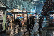 A rainy evening at the holiday market in Bryant Park.