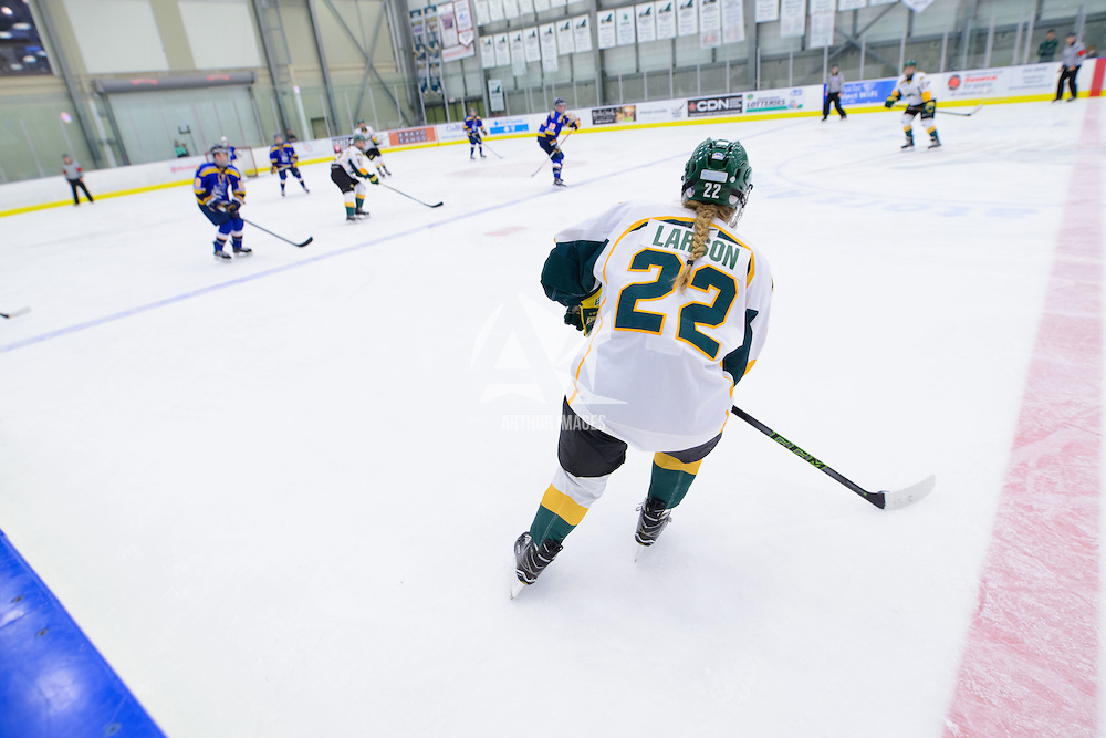 5th year defender Alexis Larson (22) of the Regina Cougars in action during the Women's Hockey Home Game on October 15 at Co-operators arena. Credit: Arthur Ward/Arthur Images