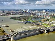 Nederland, Zuid-Holland, Rotterdam, 25-02-2020; Van Brienenoordbrug over de Nieuwe Maas. De brug bestaat uit twee boogbruggen en huisvest Rijksweg A16, richting Breda. Links het eilandVan Brienenoord<br /> Van Brienenoord bridge over the Nieuwe Maas. The bridge consists of two arched bridges. Motorway / highway A16, direction Breda.<br /> <br /> luchtfoto (toeslag op standard tarieven);<br /> aerial photo (additional fee required)<br /> copyright © 2020 foto/photo Siebe Swart
