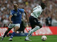 Photo: Lee Earle.<br /> England v Israel. UEFA European Championships Qualifying. 08/09/2007.England's Micah Richards (R) battles past Yaniv Katan.
