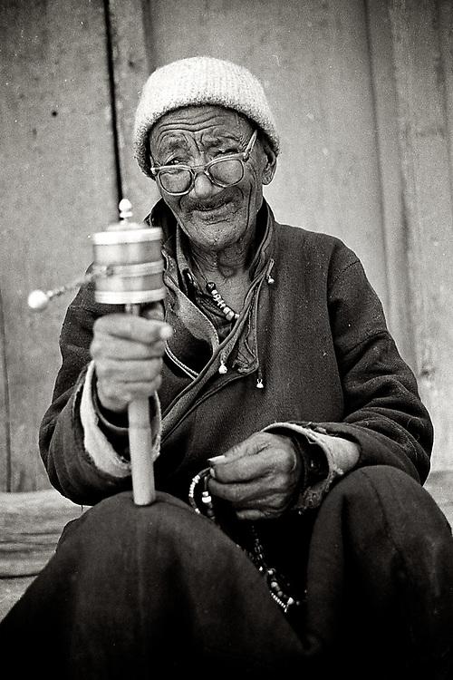 Tibetan man  praying. Leh, Ladakh. Photo by Lorenz Berna