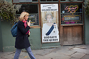 "Sign depicting Queen Elizabeth II reading ""God Save The Queen"" to celebrate her jubillee year, remains outside a pub in Spitalfields, London, UK."