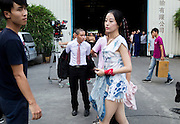GUANGZHOU, CHINA - OCTOBER 02: (CHINA OUT)<br /> <br /> Chinese Obama Imitator<br /> <br /> Xiao Jiguo who is famous for imitating American President Obama takes off clothes after shooting a scene of a comedy at a warehouse on October 2, 2015 in Guangzhou, China. Xiao Jiguo, born in Sichuan province, was well-known as an imitator of American President Barack Hussein Obama after acting in a Chinese entertainment program. He became a star among the commercial events and acted in a comedy during the Chinas National Day Holiday in Guangzhou.<br /> ©Exclusivepix Media