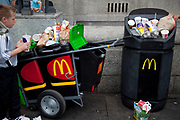 A McDonalds collection cart and bin overflow with rubbish in a popular tourist area in London. Trash is a big problem here.