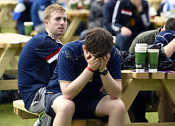 Scotland fans sit dejected at the Fan Zone in Glasgow as they watch the UEFA Euro 2020 Group D match between Scotland and the Czech Republic held at Hampden Park. Picture date: Monday June 14, 2021.