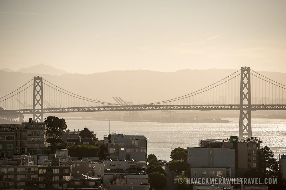 Silhouette of the San Francisco-Oakland Bay Bridge (known locally as the Bay Bridge) that connects San Francisco with Oakland across San Francisco Bay.
