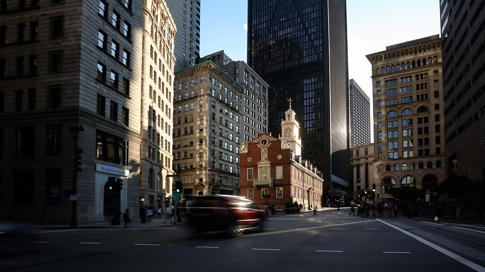 Late afternoon sunlight shining on the Old State House in downtown Boston.