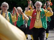 Male and female traditional Morris dancers perform at rural folk event, Shottisham, Suffolk, England
