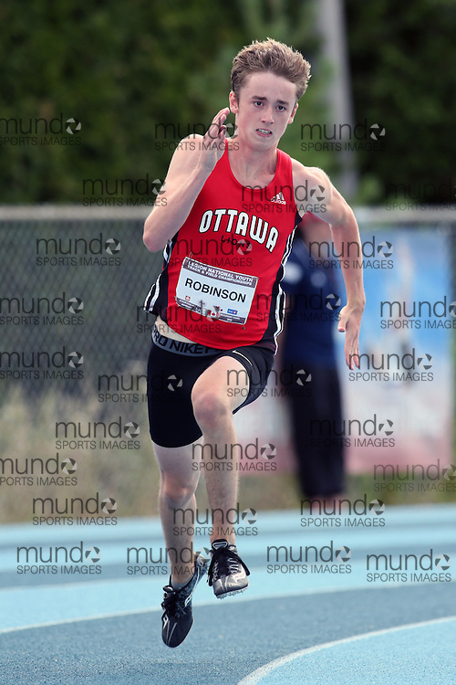 06 August 2016: Ben Robinson running in the midget boys (under-16) 200m heats at the Canadian National Youth Track and Field Championships in Sainte-Théresè / Blainville, Quebec.