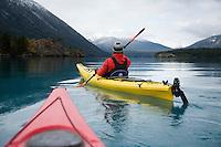 Young woman kayaking on  Chilko Lake. British Columbia, Canada
