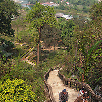 Climbing the stairs to the Tham Chang caves in Vang Vieng.
