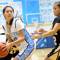010713  Adron Gardner/Independent<br /> <br /> Window Rock Scout Shariya Betsoi (12), left, posts up Chinle Wildcat Brittany Yazzie (12) in Fort Defiance Tuesday.