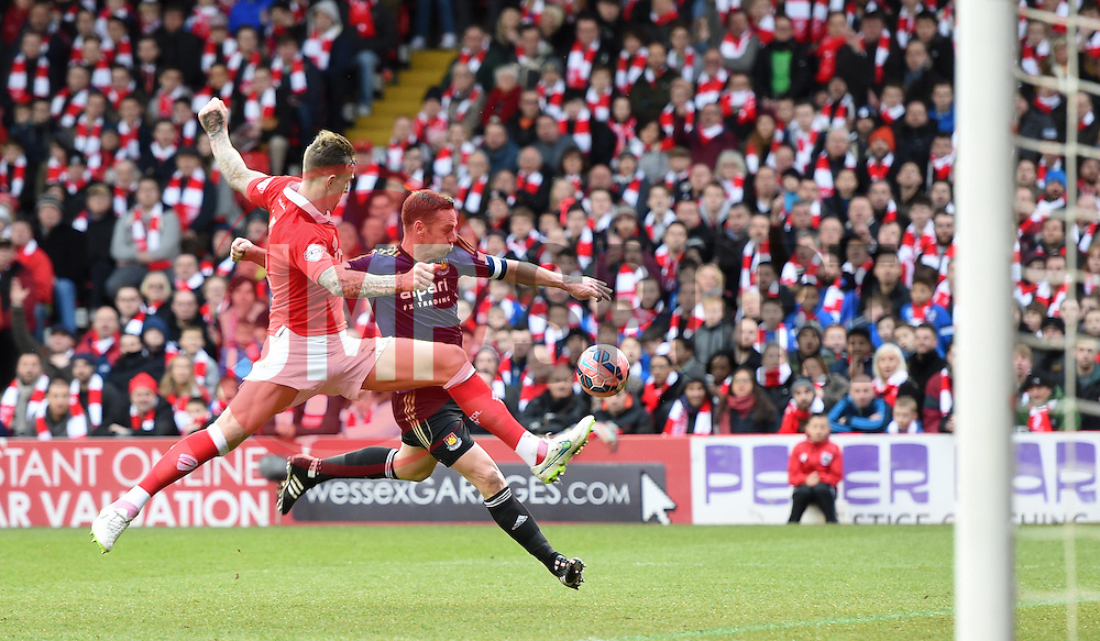 Bristol City's Aden Flint prevents West Ham's Kevin Nolan from scoring in the FA Cup fourth round match between Bristol City and West Ham United at Ashton Gate on 25 January 2015 in Bristol, England - Photo mandatory by-line: Paul Knight/JMP - Mobile: 07966 386802 - 25/01/2015 - SPORT - Football - Bristol - Ashton Gate - Bristol City v West Ham United - FA Cup fourth round