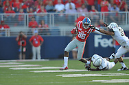 Mississippi Rebels wide receiver Cody Core (88) is chased by Vanderbilt Commodores cornerback Torren McGaster (5) and Vanderbilt Commodores linebacker Darreon Herring (35) at Vaught-Hemingway Stadium at Ole Miss in Oxford, Miss. on Saturday, September 26, 2015.