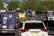 UNITED KINGDOM, London: 24 April 2020 <br /> Traffic can be seen on the A40 by Hanger Lane in West London during rush hour this morning. As the country enters it's second month of the government imposed lockdown to help prevent the spread of COVID-19, a steady rise in the number of people using the roads and returning to work is evident.
