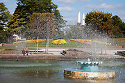 Fountains in Battersea Park. The fountain forms part of a small lake complex and is a place where people come to cool off in the spray from the summer heat.