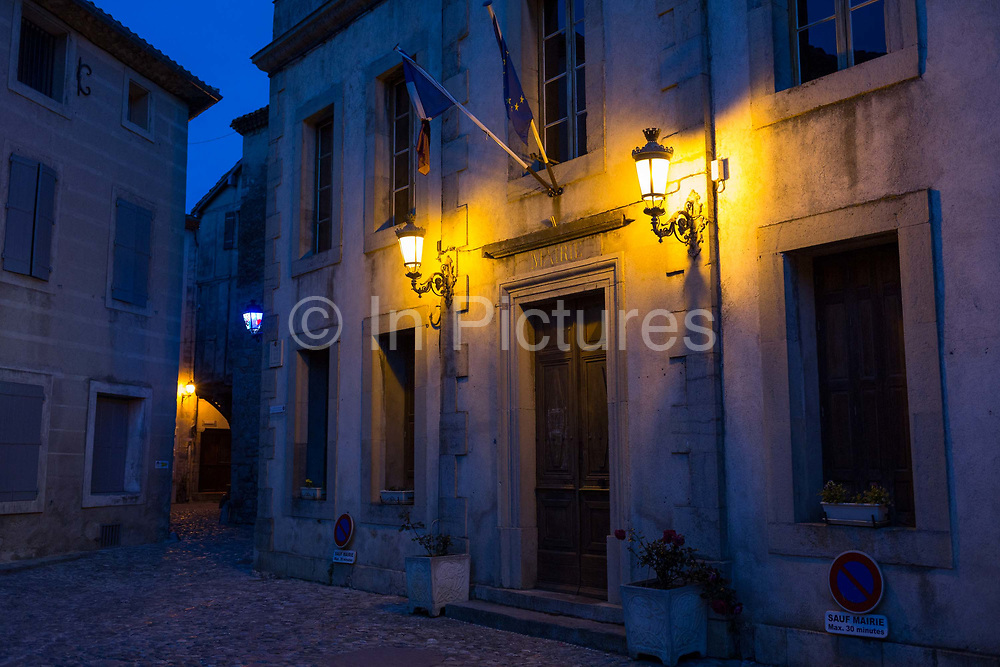 Warm light from an overhead street lamp, illuminates deserted medieval cobbled streets, on 26th May, 2017, in Lagrasse, Languedoc-Rousillon, south of France. Lagrasse is listed as one of Frances most beautiful villages and lies on the famous Route 20 wine route in the Basses-Corbieres region dating to the 13th century.