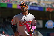Alexi Casilla #12 of the Baltimore Orioles heads to the dugout before a game against the Minnesota Twins on May 12, 2013 at Target Field in Minneapolis, Minnesota.  The Orioles defeated the Twins 6 to 0.  Photo: Ben Krause