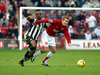 Photo: Dave Linney.<br />Walsall v Notts County. Coca Cola League 2. 25/11/2006.<br />Walsall's Martin Butler(R) loses his Notts County marker  Andy Parkinson