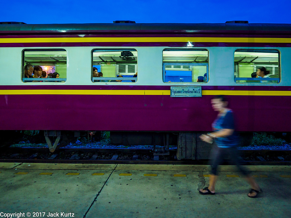 31 MAY 2017 - CHACHOENGSAO, THAILAND:  Passengers walk to get on the first train of the day at the train station in Chachoengsao, a provincial town about 50 miles and about an hour by train from Bangkok. The train from Chachoengsao to Bangkok takes a little over an hour but traffic on the roads is so bad that the same drive can take two to three hours. Thousands of Thais live outside of Bangkok and commute into the city for work on trains, busses and boats.      PHOTO BY JACK KURTZ