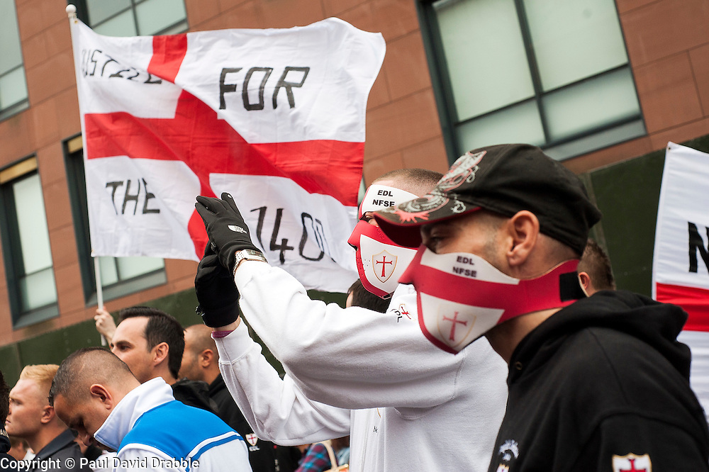 """Rotherham England<br /> 13 September 2014 <br /> EDL members outside Rotherham Main Street Police station where they held a rally as part of the English Defence Leagues """"Justice for the Rotherham 1400"""" March described by an EDL Facebook Page as """"a protest against the Pakistani Muslim grooming gangs"""" on Saturday Afternoon <br /> <br /> <br /> Image © Paul David Drabble <br /> www.pauldaviddrabble.co.uk"""