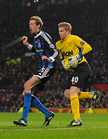 20120131: MANCHESTER, UK - Barclays Premier League 2011/2012: Manchester United vs Stoke City.<br /> In photo: Ben Amos of Manchester United collects the ball under pressure from Peter Crouch of Stoke City.<br /> PHOTO: CITYFILES