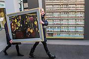 Images arrive and preparations continue for the opening. London Art Fair opens at the Business Design Centre, Islington, London.