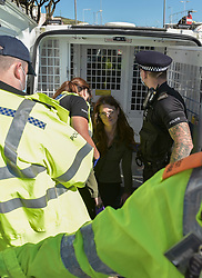 © Licensed to London News Pictures. 24/09/2021. Dover, UK. A protester being arrested. Protesters from climate change campaign group Insulate Britain block the roads entering the Port of Dover in Kent. A court injunction was placed  on the group preventing them from blocking the M25 motorway after a series of successful attempts. Photo credit: Stuart Brock/LNP