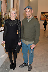 RICHARD NICOLL and FRANCESCA BURNS at a private view of photographs by David Bailey entitled 'Bailey's Stardust' at the National Portrait Gallery, St.Martin's Place, London on 3rd February 2014.