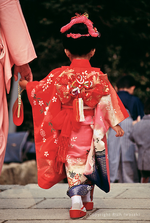 Young girl dressed in kimono visits Kibitsu Shrine during Shichi-Go-San, the festival day and rite of passage for children ages 7, 5 and 3. The shrine is located in Okayama Prefecture, Okayama, Japan.