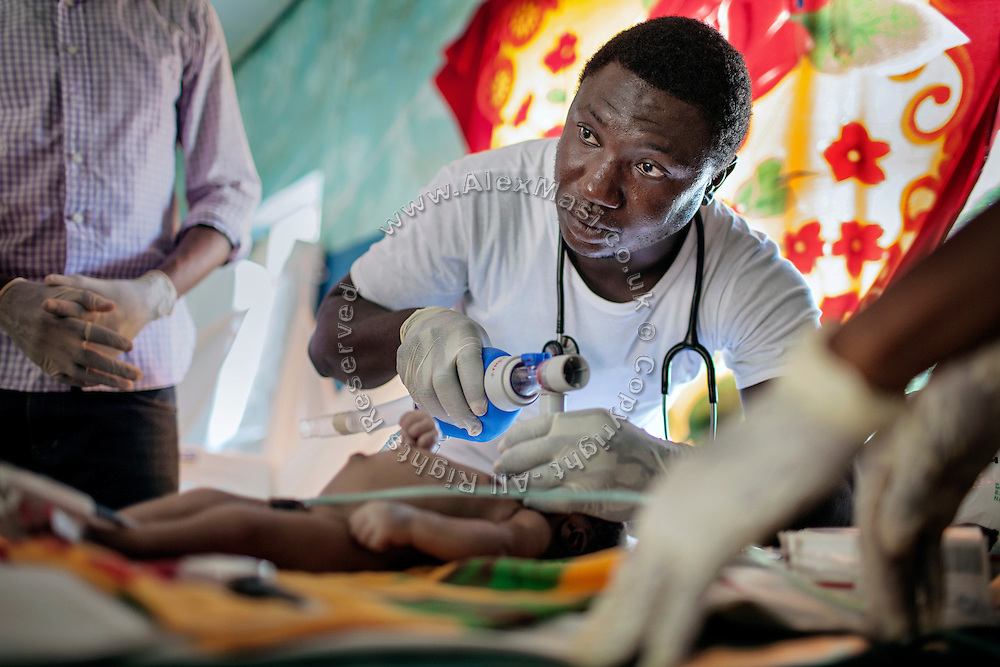 Doctors at Medecins Sans Frontieres (MSF - Doctors Without Borders) are trying to reanimate Marhazu Sa'adu, 9 days old, a child suffering from blood lead level of 49.6 micrograms per decilitre, tetanus and septicaemia, inside the MSF clinic in Anka, Zamfara State, Nigeria. Marhazu passed away within the day. The MSF facility handles serious cases of lead poisoning referred to them by local clinics in the surrounding villages. It is mainly caused by ingestion and breathing of lead particles released in the steps to isolate the gold from other metals. This type of lead is soluble in stomach acid and children under-5 are most affected, as they tend to ingest more through their hands by touching the ground, and are developing symptoms often leading to death or serious disabilities. The treatment with MSF starts when blood lead level (BLL) samples reach 45 micrograms per decilitre. The Centers for Disease Control and Prevention (CDC) states that a BLL of 5 micro-g/dL or above is a cause for concern. The cycle of medicines lasts for 20 days. After that, the child's blood is tested and a new round of treatment is provided. Treatment can last years, as lead is reduced in the blood, but it persists noticeably within the bones, especially if the patients return to the same polluted environment. Remediation of the affected villages, a campaign of awareness, and the introduction of safer mining techniques are pivotal to the long-term solution of a hazardous trend that has already killed over 460 children, and it is bound to grow in size, fostered by the ever-rising price of gold.