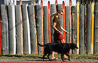 A young woman walks her dog in the town of Jackson, Wyoming.