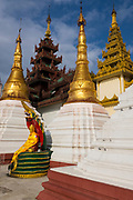 Statues and spires in the Shwedagon Pagoda complex. situated on Singuttara Hill in the center of Yangon (Rangoon), is the most sacred Buddhist stupa in Myanmar and one of the most important religious reliquary monuments in the world