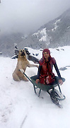 "Girl And Her Dog Rescue A Mother Goat And Her Newborn Baby <br /> <br /> This is 11-year-old Hamdü Sena Bilgin. She lives in a small village outside the city of Rize, in Turkey. Hamdü Sena and her family operate a small farm, where they raise goats for their milk. She serves as goatherd, the animals' protector and guide.<br /> <br /> Her dog, Tomi, is always by her side to help, even during the cold winter months. Recently, while Hamdü Sena and her loyal pup were tending to goats grazing on a snowy hillside far from home, one of them suddenly went into labor. Fearing that the goat, and her soon-to-be-arriving baby, would be too weak to make it back on their own, the young goatherd sprang into action.<br /> <br /> ""After the goat gave birth, I led the rest of the herd back to their shelter,"" Hamdü Sena said, ""Then I grabbed two backpacks from the house and went back to the goat and her baby with Tomi.""<br /> <br /> Although the backpacks are normally filled with books and school supplies, on this day, their cargo would be far more precious indeed. Once back at the spot, Hamdü Sena loaded the mother goat into her backpack, and put the fragile baby into the other. Tomi carried her.<br /> <br /> ""He's a good dog,"" Hamdü Sena said. ""Very smart.""<br /> <br /> Together, they slogged through the steep, wintery terrain to bring the new family to safety. ""The snow was so thick, I was exhausted,"" said Hamdü Sena. ""But it was worth it.""<br /> <br /> She was joined near the end of the trek by her brother, who captured photos of the rescue in action. Thanks to Hamdü Sena and Tomi's dedication to the animals they tend, the mother goat and her baby are now both safe and sound. But while the heroic 11-year-old might consider it her duty to the herd to protect them all from harm<br /> ©Hamdü Sena Bilgin/Exclusivepix Media"