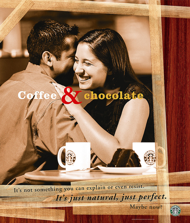 Couple hugging in coffee shop.