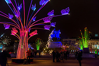 Promenons-nous  - Place Bellecour, Lyon 2<br /> Artist TILT<br /> TheFestival of Lights inLyon,Franceexpresses gratitude towardMary, mother of Jesusaround December 8th of each year.<br /> This uniquely Lyonnaise tradition dictates that every house place candles along the outsides of all the windows to produce a spectacular effect throughout the streets. The festival includes other activities based on light and usually lasts four days, with the peak of activity occurring on the 8th. <br /> The two main focal points of activity are typically theBasilica of Fourvierewhich is lit up in different colours, and thePlace des Terreaux, which hosts a different light show each year.<br /> Spared from plague<br /> The origins of the festival date to 1643 when Lyon was struck byplague. <br /> On September 8,1643 the municipal councillors promised to pay tribute to Mary if the town was spared. Ever since, a solemn procession makes its way to the Basilica of Fourviere on 8 December (the feast of theImmaculate Conception) to light candles and give offerings in the name of Mary. <br /> In part, the event thus commemorates the day Lyon was consecrated to the Virgin Mary.