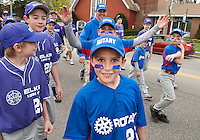 Rotary majors Ryan Hebert marched down North Main Street along with a sea of Laconia Little Leaguers for opening day ceremonies at Colby Field followed by game time on Saturday morning.  (Karen Bobotas/for the Laconia Daily Sun)