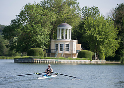 © Licensed to London News Pictures. 15/06/2021. Henley-on-Thames, UK. A rower makes his way along the River Thames at Henley-on-Thames in Oxfordshire on a hot summer's morning. Photo credit: Ben Cawthra/LNP
