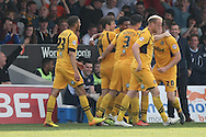 Kevin Feely of Newport is mobbed by his team-mates after scoring his side's second goal, while a smiling Newport manager Justin Edinburgh watches on. Skybet football league two match, Newport county v Rochdale at Rodney Parade in Newport, South Wales on Saturday 3rd May 2014.<br /> pic by Mark Hawkins, Andrew Orchard sports photography.
