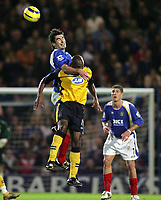 Photo: Lee Earle.<br /> Portsmouth v Wigan Athletic. The Barclays Premiership. 05/11/2005. Portsmouth's Richard Hughes applies pressure to Damien Francis.