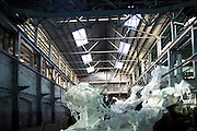 Artist Peter Robinson's vast polystyrene installation on display in the former shipyard known as the heavy machine shop, Cockatoo Island, Sydney. Part of the 18th Biennale of Sydney exhibition. .09.07.12