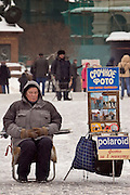 Moscow, Russia, 20/02/2005..A souvenir photographer waits for customers in a snowbound Red Square.