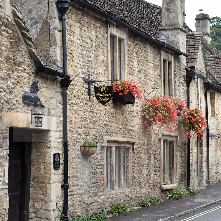 Castle Combe UK Aug 2020: the main street between the typical houses of Castle Combe in Wiltshire.