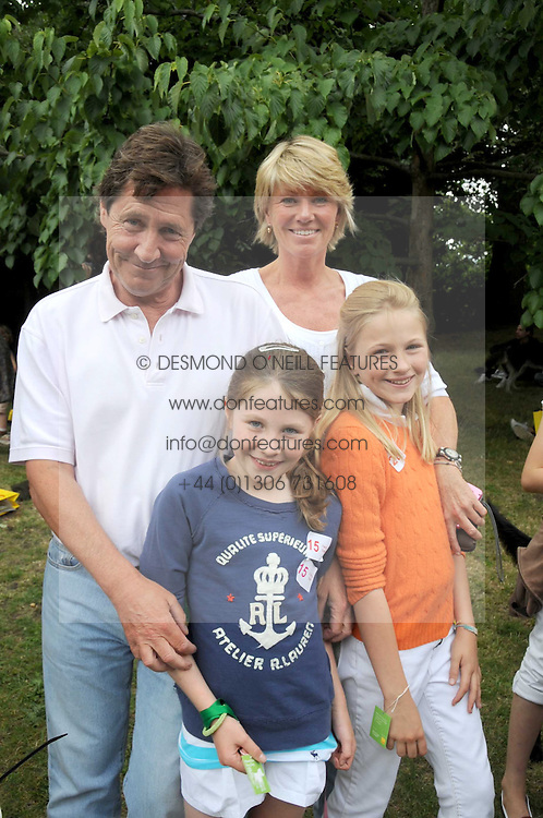 SIMON & KATE SLATER with their daughters left to right, ROSE SLATER and FLORA SLATER at the Macmillan Dog Day in aid of Macmillan Cancer Support held at the Royal Hospital Chelsea, London on 8th July 2008.<br /><br />NON EXCLUSIVE - WORLD RIGHTS
