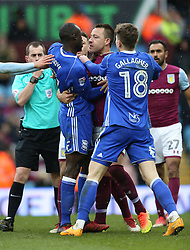 Aston Villa's John Terry (centre right) and Birmingham City's Cheikh N'Doye (centre left) clash leading to the later receiving a red card