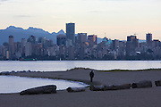 Jericho Beach. Downtown Vancouver's Skyline across Burrard Inlet, at sunset.