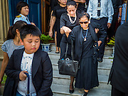 14 OCTOBER 2016 - BANGKOK, THAILAND:  Mourners leave the Sahathai Samakom Pavilion at the Grand Palace in Bangkok after paying respects to Bhumibol Adulyadej, the King of Thailand, who died Oct. 13, 2016. He was 88. His death comes after a period of failing health. With the king's death, the world's longest-reigning monarch is Queen Elizabeth II, who ascended to the British throne in 1952. Bhumibol Adulyadej, was born in Cambridge, MA, on 5 December 1927. He was the ninth monarch of Thailand from the Chakri Dynasty and is known as Rama IX. He became King on June 9, 1946 and served as King of Thailand for 70 years, 126 days. He was, at the time of his death, the world's longest-serving head of state and the longest-reigning monarch in Thai history.    PHOTO BY JACK KURTZ