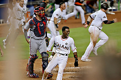 June 19, 2017 - Miami, FL, USA - Miami Marlins' Dee Gordon crosses homeplate to score the winning run in the bottom of the ninth inning off a Marcell Ozuna RBI against the Washington Nationals on Monday, June 19, 2017 in Miami, Fla. (Credit Image: © Patrick Farrell/TNS via ZUMA Wire)